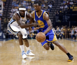 Golden State Warriors forward Harrison Barnes (40) dribbles past Memphis Grizzlies forward Zach Randolph during the first half of Game 6 of a second-round NBA basketball Western Conference playoff series Friday, May 15, 2015, in Memphis, Tenn. (AP Photo/Mark Humphrey)